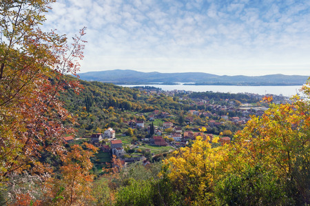 Sunny autumn landscape.  Montenegro, view of Tivat city and Lustica peninsula from the slope of the mountain Standard-Bild
