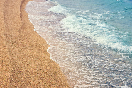 Sandy beach, background. Montenegro, Adriatic Sea, Kotor Bay Stok Fotoğraf