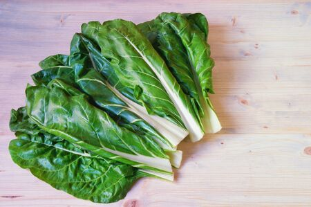 Balkan cuisine. Blitva ( chard leaves ) - popular leafy vegetables. White rustic background, free space for text