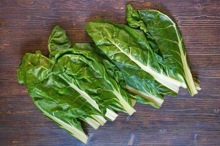 Balkan cuisine. Blitva ( chard leaves ) - popular leafy vegetables. Dark rustic background