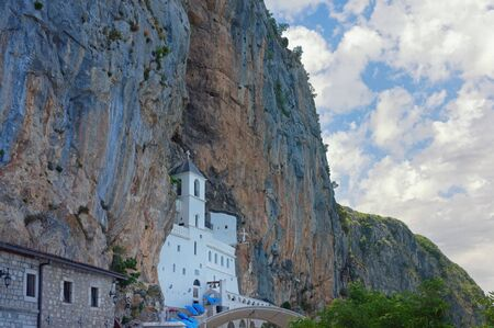Ancient Ostrog monastery, located in an almost vertical rock. Montenegro Stock Photo