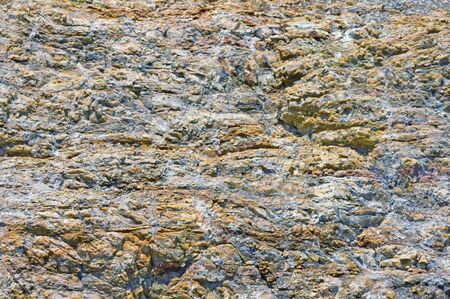 Stone background, texture of mountain cliff on a sunny day. Montenegro, Dinaric Alps Imagens