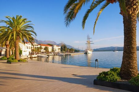 Travel concept. Embankment of Tivat city on sunny autumn day. Montenegro, Adriatic Sea, Bay of Kotor Stockfoto