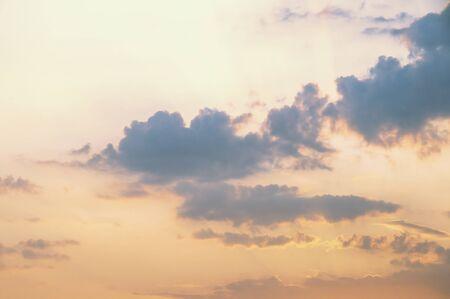 Dark clouds in the sunset sky. Cumulus clouds lit by the setting sun