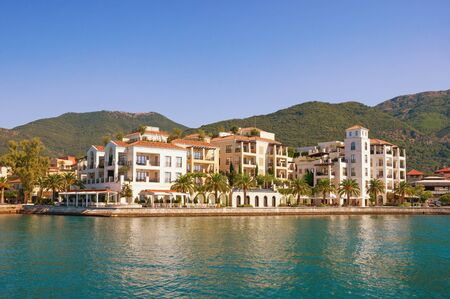 Beautiful view of embankment of Tivat city from sea on sunny day. Montenegro, Adriatic Sea, Kotor Bay Stockfoto