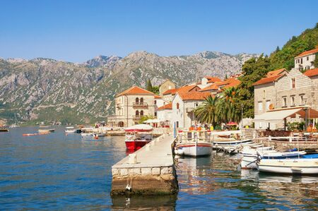Beautiful Mediterranean landscape. Montenegro, Adriatic Sea, Bay of Kotor. View of ancient town of Perast on sunny autumn day
