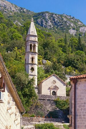 Religious architecture. Montenegro, Perast town. View of  Church of Our Lady of Rosary on sunny autumn day Stockfoto