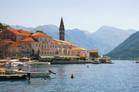 Beautiful Mediterranean landscape. Montenegro, Adriatic Sea, Bay of Kotor. View of ancient town of Perast  with bell tower of church of St. Nicholas Stockfoto