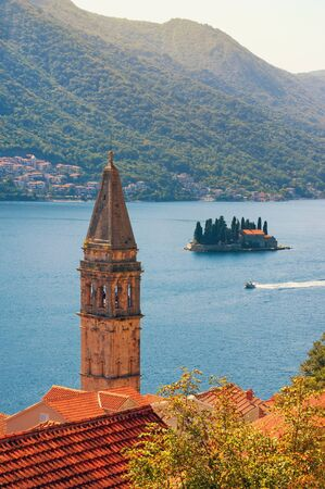 Beautiful autumn Mediterranean landscape. Montenegro, Bay of Kotor, Perast town. View of Island of Saint George and  and bell tower of the Church of St. Nicholas. Travel and tourism concept