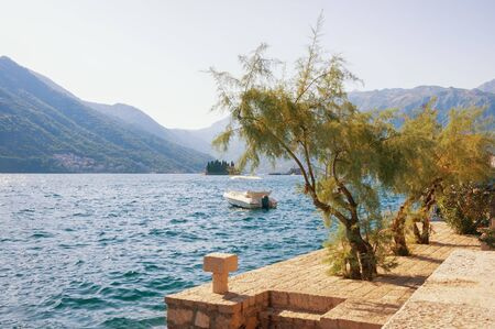 Beautiful Mediterranean landscape. View of Kotor Bay near ancient town of Perast on sunny autumn day. Montenegro, Adriatic Sea