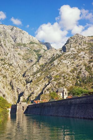 Montenegro, Old Town of Kotor -    site.  View of northern walls  of old fortress  Skurda river on sunny autumn day