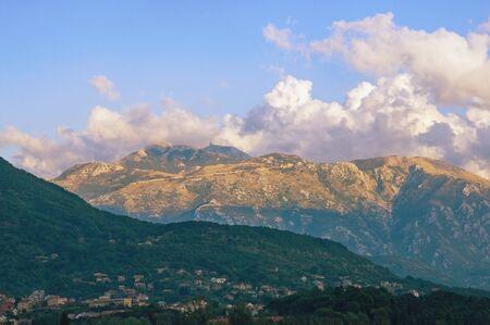 Picturesque mountain range. Montenegro, Dinaric Alps. View of peaks of Lovcen mountain from Tivat city, autumn Stockfoto