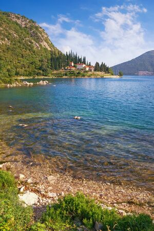 Beautiful summer Mediterranean landscape. Montenegro, Adriatic Sea. View of  Bay of Kotor near Risan town. Banja Monastery is in the distance