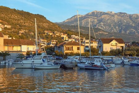 Picturesque autumn Mediterranean landscape.  Montenegro, Adriatic Sea, Bay of Kotor. View of Marina Kalimanj in Tivat city and  mountains of Lovcen