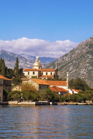 Beautiful Mediterranean landscape. Montenegro, Adriatic Sea. View of Kotor Bay, Prcanj town and Birth of Our Lady Church Stockfoto