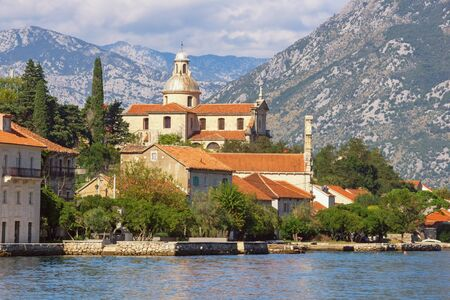 Montenegro. View of Prcanj town and Birth of Our Lady Church. Kotor Bay of Adriatic Sea