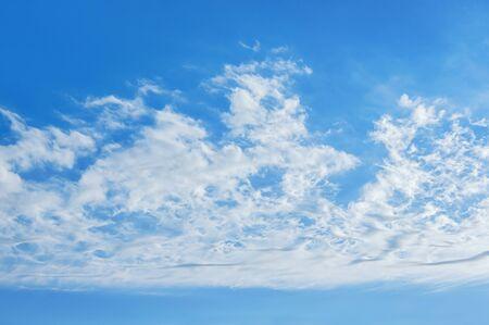 Strip of white clouds in blue sky , background. Cirrocumulus clouds