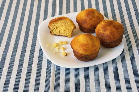 Balkan cuisine. Proja -  dish made of corn flour.  Cornbread, prepared as a muffin , on white plate