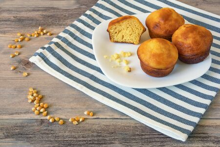 Balkan cuisine. Proja -  dish made of corn flour.  Cornbread, prepared as a muffin , on white plate and rustic background