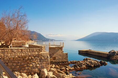 Sunny winter Mediterranean landscape. Montenegro, Adriatic Sea. View of Bay of Kotor near Herceg Novi city