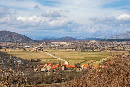 Balkan road trip. Bosnia and Herzegovina, Republika Srpska, Zubacko polje. View of village of Grab and road to Trebinje city
