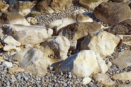 Different stones and pebbles on sunny day, natural background. Montenegro