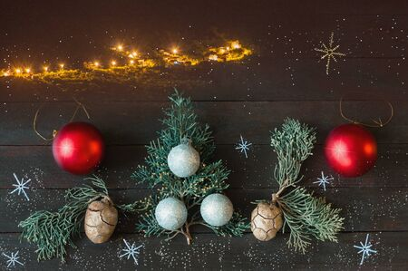 Christmas. Christmas decorations on dark rustic background; landscape with small village at night, - digital composite 写真素材