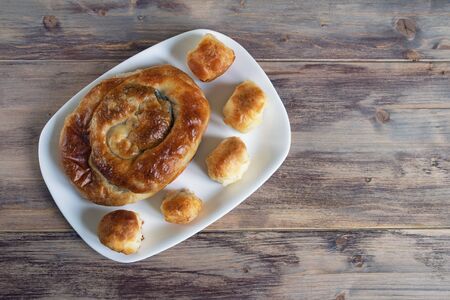Balkan cuisine. Burek with cheese,  popular national dish.  Flat lay. Free space for text