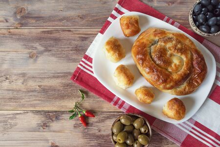 Balkan cuisine. Burek is family of baked filled pastries. Burek with cheese,  popular national dish.  Flat lay. Free space for text