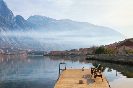 Misty Mediterranean landscape. Montenegro, view of Bay of Kotor and Prcanj town in winter