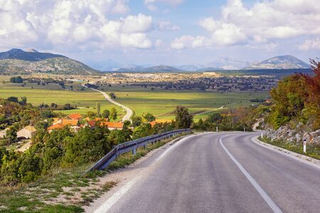Balkan road trip. Dinaric Alps, Bosnia and Herzegovina, Republika Srpska, Zubacko polje. View of village of Grab and road to Trebinje city in autumn 写真素材