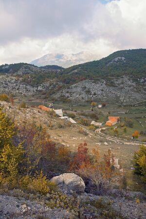Mountain landscape with small village on cloudy autumn day. Balkans, Dinaric Alps, Montenegro, Sitnica region