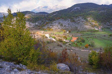 Autumn landscape with small village in mountains. Balkans, Dinaric Alps, Montenegro, Sitnica region