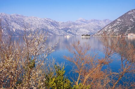 Beautiful Mediterranean landscape on sunny spring day. Montenegro, Adriatic Sea, Bay of Kotor. View of two islets off coast of Perast town