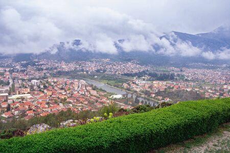 Foggy spring day. View of Trebinje city from Crkvina Hill. Bosnia and Herzegovina, Republika Srpska