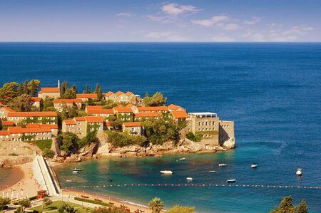 Beautiful mediterranean landscape. Montenegro, Adriatic coast. View of island of Sveti Stefan on sunny summer day