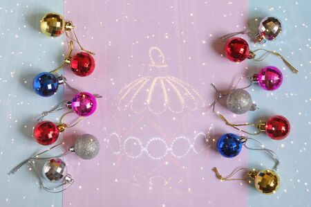 Christmas decorations. Bright Christmas balls of different sizes on the background of colored paper. Flat lay, free space for text