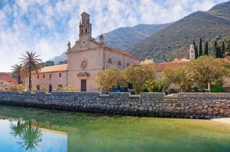 View of Prcanj town and St. Nicholas Church on sunny spring day.  Montenegro, Kotor Bay