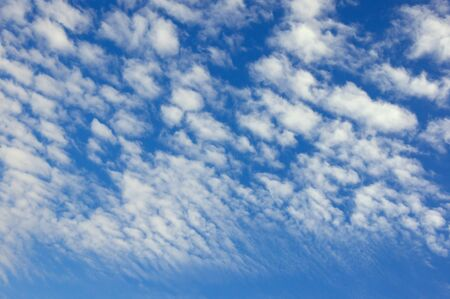 White clouds in blue sky, background . Altocumulus cloud formation 写真素材