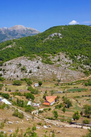 Summer mountain landscape with small village on sunny day. Dinaric Alps, Montenegro, Sitnica region 写真素材