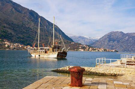 Beautiful winter Mediterranean landscape. Montenegro, Adriatic Sea. View of Bay of Kotor. View of Prcanj town from town of Dobrota ( near Kotor city ) Zdjęcie Seryjne