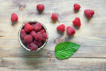 Red-fruited raspberries.  Raspberry fruits on rustic table. Flat lay