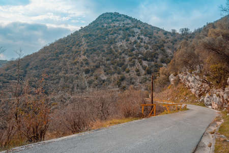 Balkan road trip. Mountains landscape with winding country road. Montenegro, Tivat