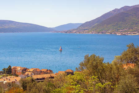 Sunny vacation concept. Beautiful Mediterranean landscape. Montenegro, Adriatic Sea, view of Bay of Kotor near Tivat city