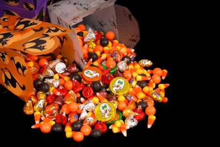 Colorful halloween candy in chinese containers