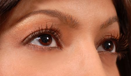 A closeup of attractive womans brown eyes