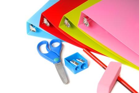 School supplies including binders, scissors, pencil, pencil sharpener and eraser Stock Photo - 1425735