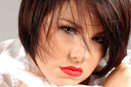A beautiful dark haired woman in a sultry pose