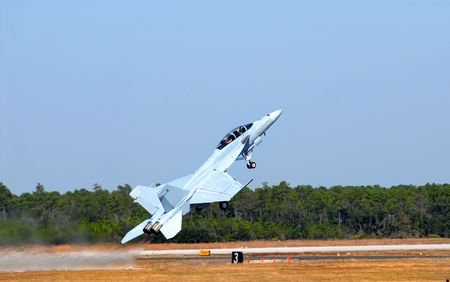 An F-18 taking off in a steep incline