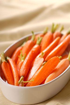 Fresh organic honey glazed  carrots in a serving bowl 스톡 콘텐츠